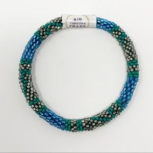 New Aid Through Trade Roll On Bracelet